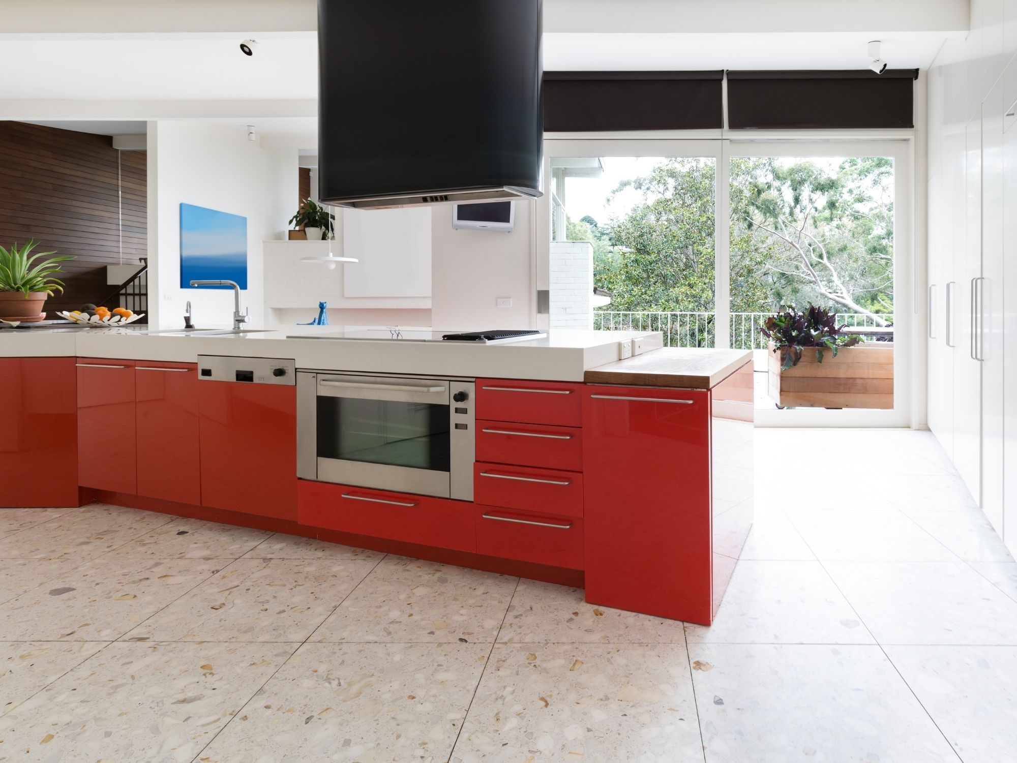 Modern kitchen layout with red and white styling